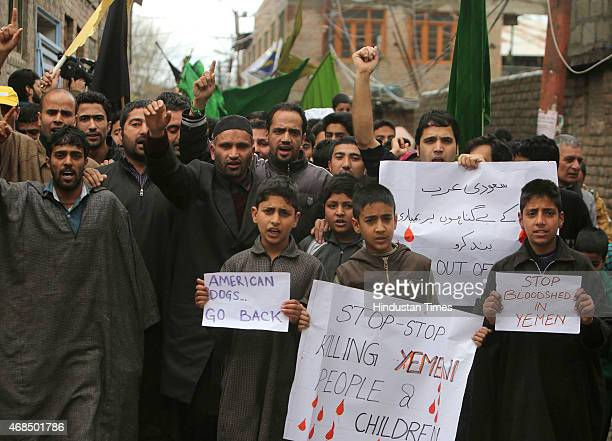 Kashmiri Shia Muslims shout slogans as they hold placards during a protest against a Saudiled coalitions operation in Yemen on April 3 2015 in...