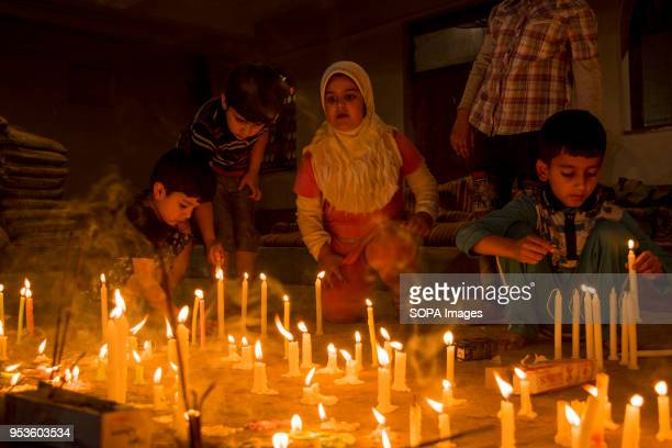 Kashmiri Shiite Muslim children light candles at the grave of their relatives to Mark ShabeBarat in Srinagar the summer capital of Indian controlled...