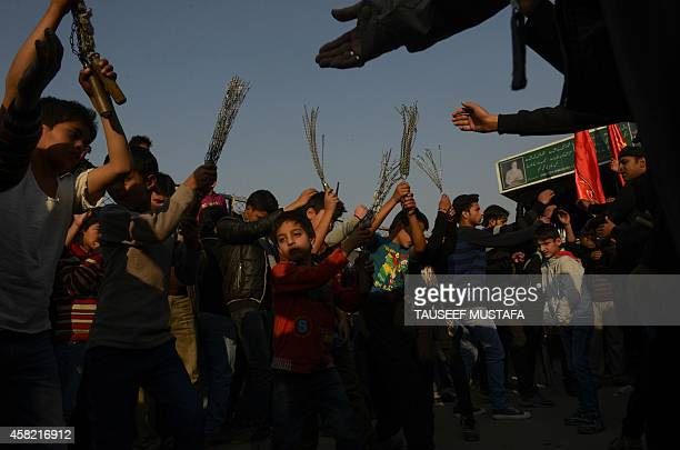 Kashmiri Shiite Muslim devotees beat themselves with chains during a selfflagellation ritual at a religious procession held on the seventh day of...