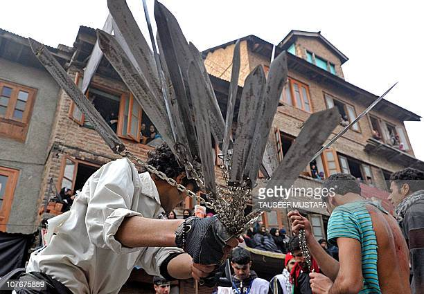 Kashmiri Shiite Muslim flagellates himself with a cluster of knives during a Ashura procession in Srinagar on December 17 2010 held on the tenth day...