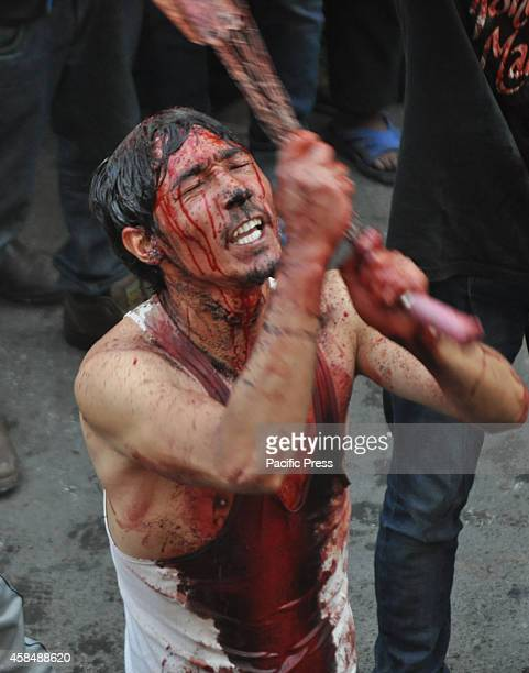Kashmiri Shiite Muslim flagellates himself with knives during Ashura procession in Jammu Thousands of devotees gathered for a procession that ended...