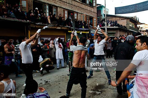 Kashmiri Shiite Muslim flagellates themselves with knives during an Ashura procession on November 15 in Srinagar the summer capital of Indian...