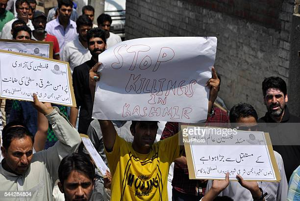 A Kashmiri Shiite Muslim Holds a prokashmir play card during a Quds day protest in old city Srinagar on July 12016Quds Day is marked on every last...