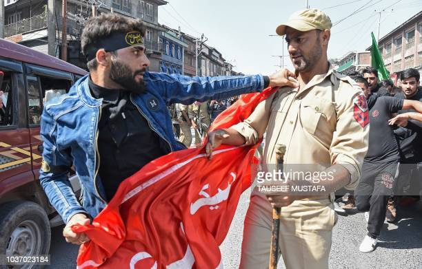 A Kashmiri Shiite Muslim is detained by Indian police as devotees defy restrictions for a Muharram procession in Srinagar on September 21 2018 Indian...