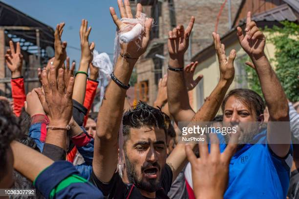 Kashmiri Shiite Muslim mourners shout religious slogans as they try to bring out Muharram procession on September 19 2018 in Srinagar the summer...