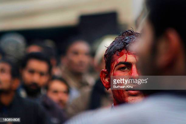 Kashmiri Shiite Muslim smeared in blood takes part in Ashura procession on December 17, 2010 in Srinagar, the summer capital of Indian administered...