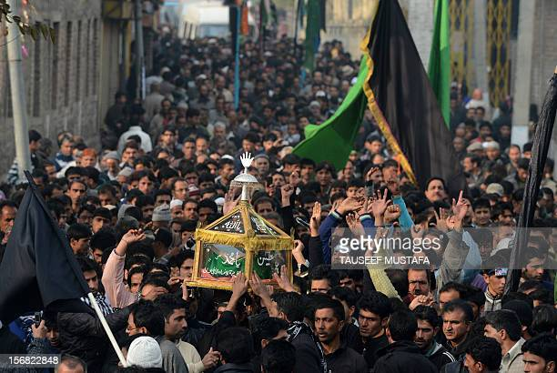 Kashmiri Shiite Muslims gather during a religious procession held on the seventh day of Ashura, in Srinagar on November 22 as they remember the...