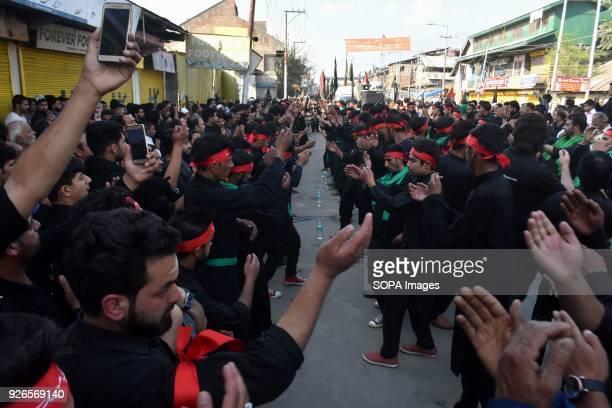 Kashmiri Shiite Muslims participate in a ritual to commemorate the martyrdom of Imam Hussain, the grandson of Islam's Prophet Muhammad. Shiite...
