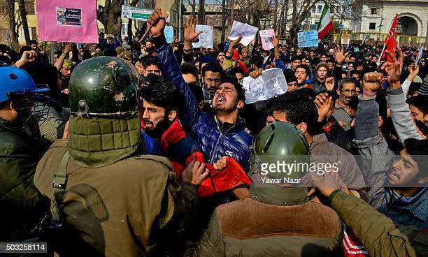 Kashmiri Shiite protesters shout antiSaudi government slogans as Indian government forces attempt to stop them during a protest against the execution...