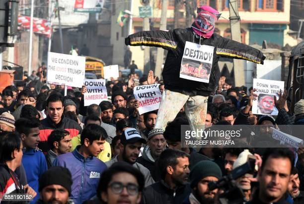 Kashmiri Shitte Muslim shout slogans against the United States and Israel as they carry an effigy of a US President Donald Trumph during a protest in...
