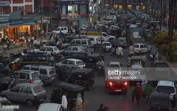Kashmiri shoppers and commuters pass through Lal Chowk the main market in central Srinagar on September 25 2016 Markets across Indianadministered...