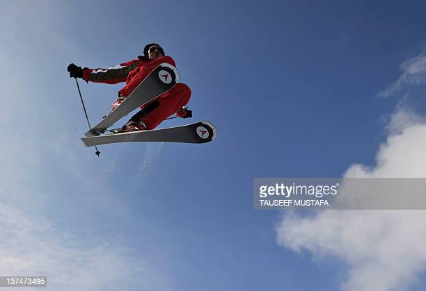 Kashmiri skier Ayaz Zargar soars in the air at a ski resort in Gulmarg, some 55kms west of Srinagar, on January 21, 2012. Gulmarg, situated in the...