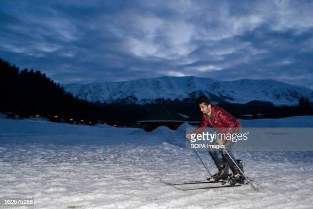 Kashmiri skier makes his way down a slope at a ski resort in Gulmarg some 55kms west of Srinagar Gulmarg situated in the foothills of The Himalayas...