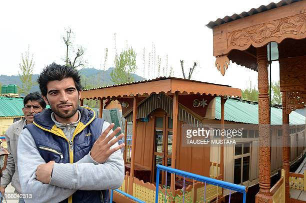 Kashmiri son of houseboat owner, Syed Ahmed Shoda speaks with an AFP journalist outside the houseboat where a young British woman was found murdered,...
