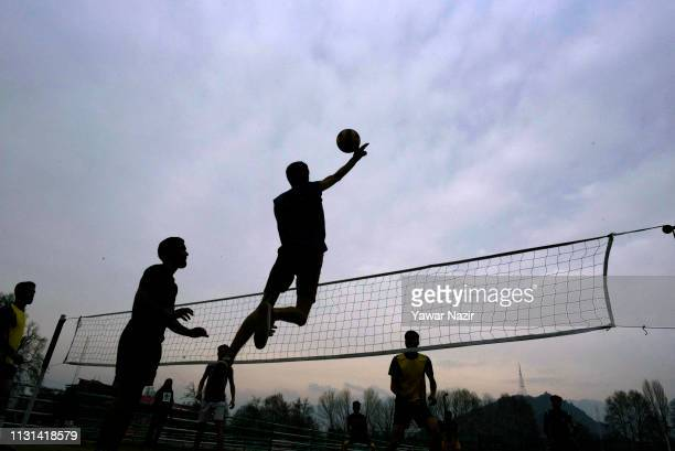 Kashmiri Sportsmen are silhouetted against the sky as they play handball in a playground on March 18 2019 in Srinagar the summer capital of Indian...