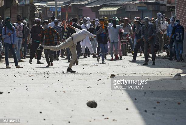 TOPSHOT Kashmiri stone pelters clash with Indian police after Friday prayers during the Holy month of Ramadan in downtown Srinagar on June 1 2018