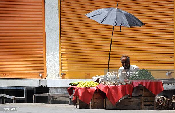 A Kashmiri street vendor waits for customers during a strike in Srinagar on July 25 2009 The strike called by the hardline faction of Muslimmajority...