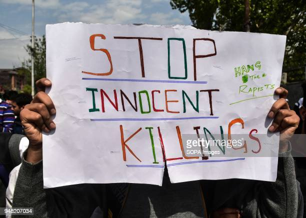 Kashmiri student holds a placard during a protest against the rape and murder of an eightyearold girl in Srinagar Indian administered Kashmir...
