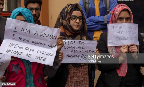 Kashmiri student protesters hold, placards during a protest against the rape and murder of a eight year old Muslim girl in Srinagar, the summer...