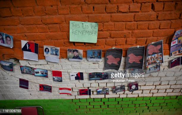 Kashmiri students and civil society activists hang photos of family and friends during an event to observe Eid alAdha away from home at Jantar Mantar...