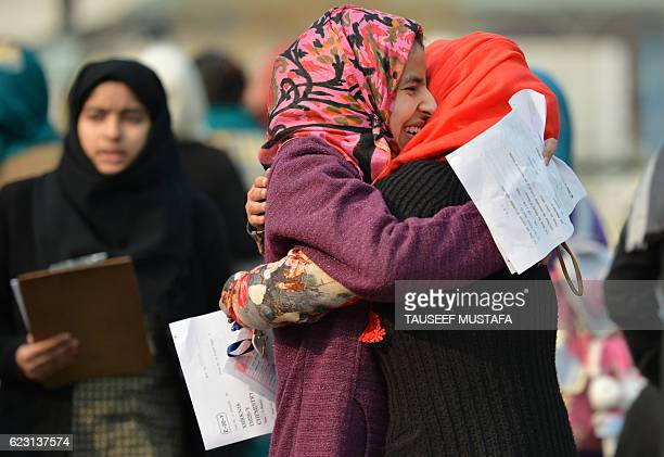 Kashmiri students greet each other as they leave after sitting secondary school exams at an examination centre in Srinagar on November 14 2016...