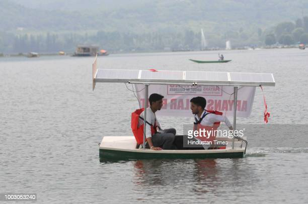 Kashmiri students of Chandigarh based Aryans Group of Colleges display a solar boat made by them for implementing the idea of solarpowered boats...