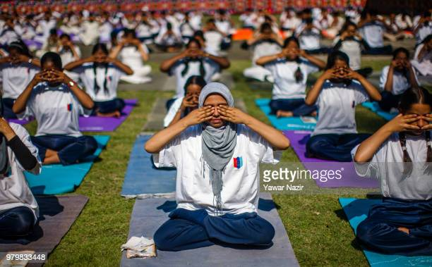 Kashmiri students perform Yoga in a stadium on June 21 in Srinagar the summer capital of Indian administered Kashmir India Yoga which means union in...