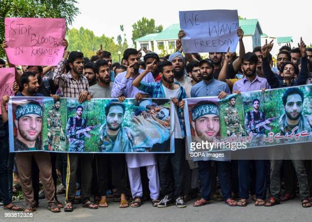 Kashmiri students shout pro freedom slogans during a protest rally on the eve of the second death anniversary of the rebel commander Burhan Muzaffar...