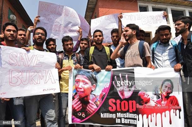 Kashmiri students shout slogans during a protest against the treatment of Rohingya Muslims in Myanmar in Srinagar capital of the Indian administered...