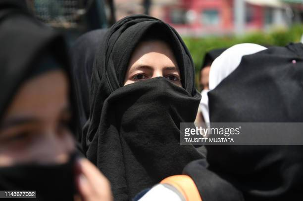 Kashmiri students take part in a protest in Srinagar on May 14 as protesters called for justice in the case of the alleged rape of a threeyearold girl