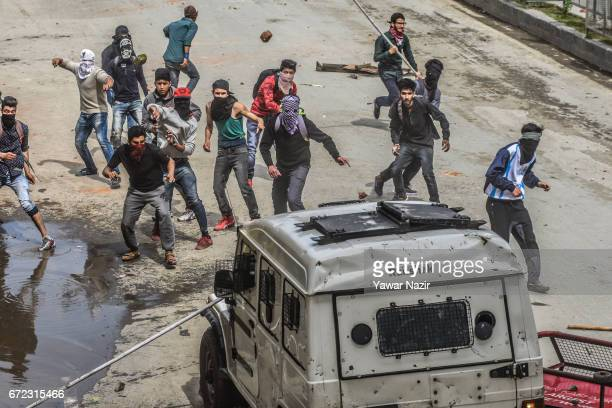 Kashmiri students throw stones and bricks at Indian government forces during a protest against the attack by Indian government forces on students on...