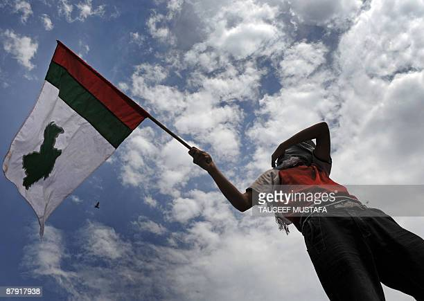 A Kashmiri supporter of Democratic Freedom Party waves a party flag during a rally in downtown Srinagar on May 22 2009 The release of Shabir Shah the...