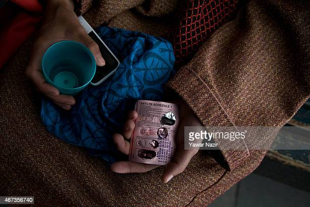 Kashmiri Tuberculosis patient shows his antiTB medicines which he takes daily at Kashmir's lone chest diseases hospital on March 23 2015 in Srinagar...