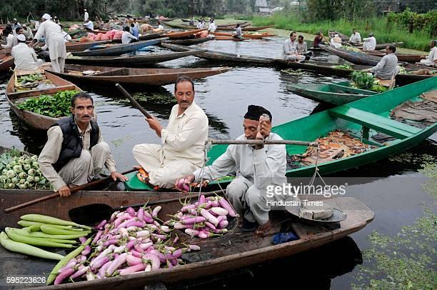 Kashmiri vendors selling vegetables at the floating vegetable market on Dal Lake on August 25 2016 in Srinagar India In the ongoing Kashmir turmoil...