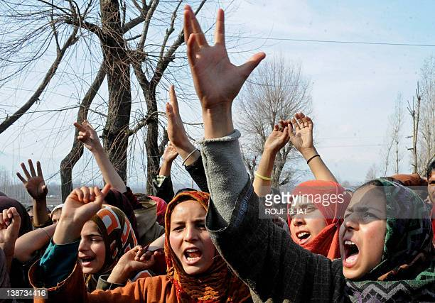 Kashmiri vilagers shout antiIndia slogans as they mourn the death of Ashiq Hussain Rather during a funeral procession in Lesar village in the...