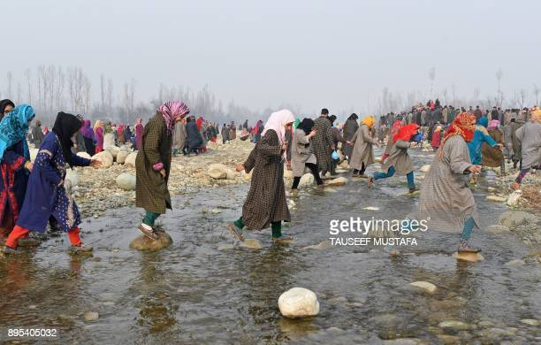 TOPSHOT Kashmiri villagers arrive for the funeral procession of militant Tanveer Ahmed and resident Ruby Jan at Batmurran Kellar village in Shopian...