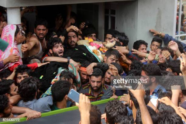 Kashmiri villagers carry body of senior militant Arif Nabi Dar Alias Arif Lilhar during his funeral procession in Lilhar about 35 kilometers south of...