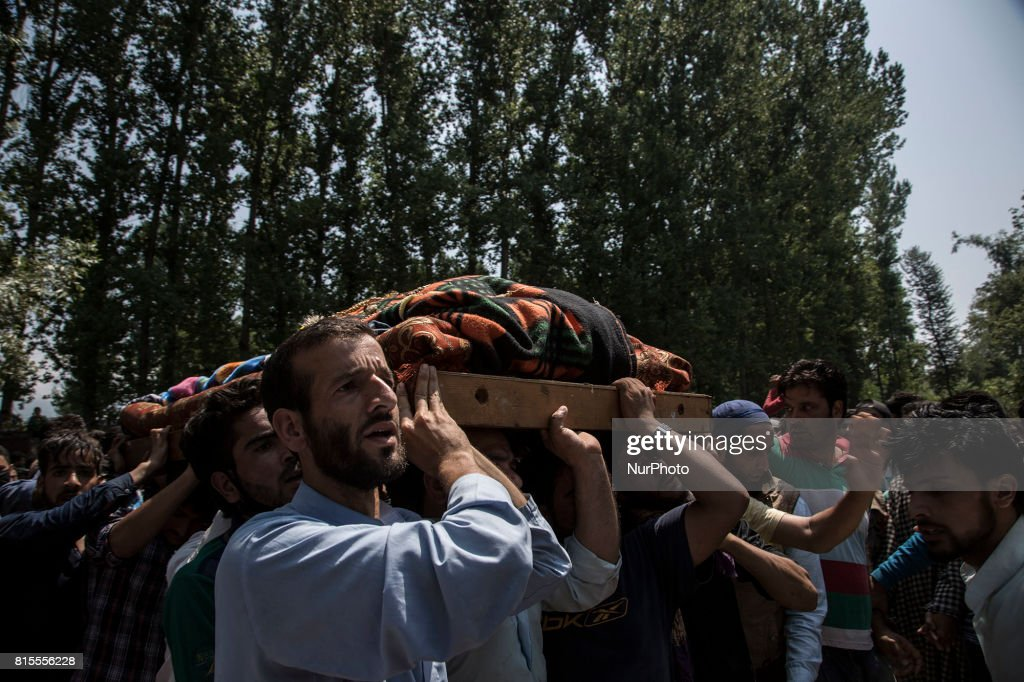 Kashmiri villagers carry the body of a local rebel Parvaiz Mir during his funeral procession, Sunday, July 16, 2017, in Pohoo village 38 kilometers (24 miles) south of Srinagar, Indian-administered Kashmir. Mir was killed along with two other rebels including a foreign national in a gunfight at a forest area in south Kashmirs Pulwama district on Saturday, police said.