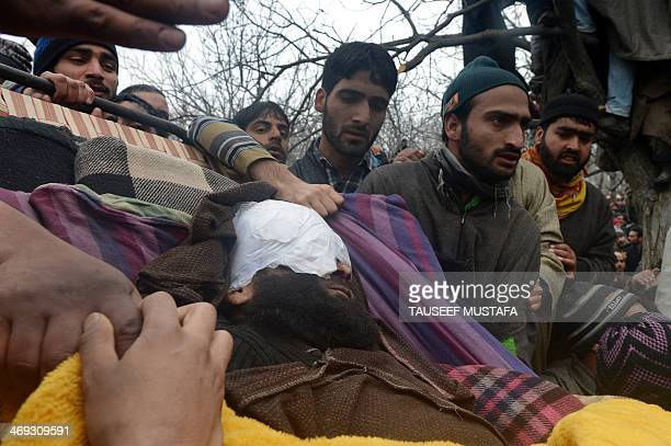 Kashmiri villagers carry the body of alleged Hizbul Mujahideen militant Arshid Ahmed during his funeral in Shopian some 60 kms south of Srinagar on...