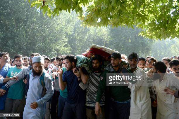 TOPSHOT Kashmiri villagers carry the body of slain militant Ayub Lelhari during his funeral procession at Lelhar village of Pulwama district south of...