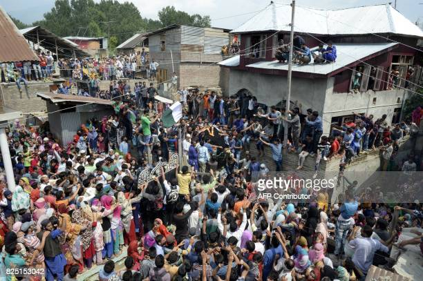 TOPSHOT Kashmiri villagers carry the body of suspected rebel Arif Lelhari during his funeral in the Lelhar village of Pulwama on August 1 2017 Indian...