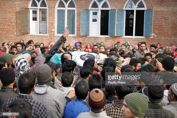 Kashmiri villagers carry the body of top militant commander Noor Mohammad Tantray during his funeral in the Aripal village of Tral district on...