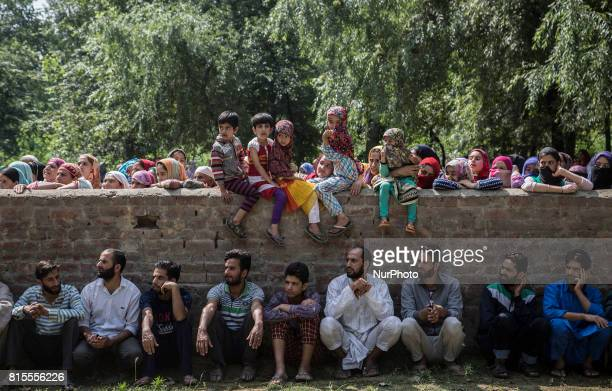 Kashmiri villagers including children watch the funeral procession of a local rebel Parvaiz Mir during his funeral Sunday July 16 in Pohoo village 38...