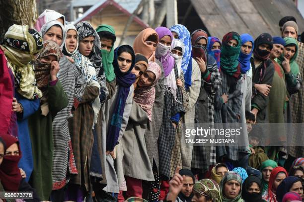 Kashmiri villagers look on during the funeral of militant commander Noor Mohammad Tantray in the Aripal village of Tral district on December 26 2017...