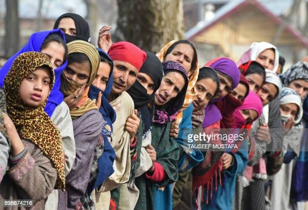 TOPSHOT Kashmiri villagers look on during the funeral of militant commander Noor Mohammad Tantray in the Aripal village of Tral district on December...