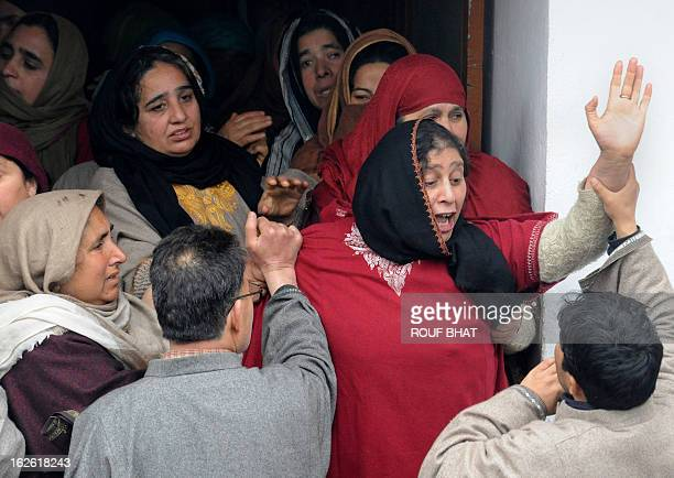Kashmiri villagers mourn during the funeral of ruling National Conference Sarpanch Javed Ahmad Wani in Kalantra village of north Kashmir's Baramulla...