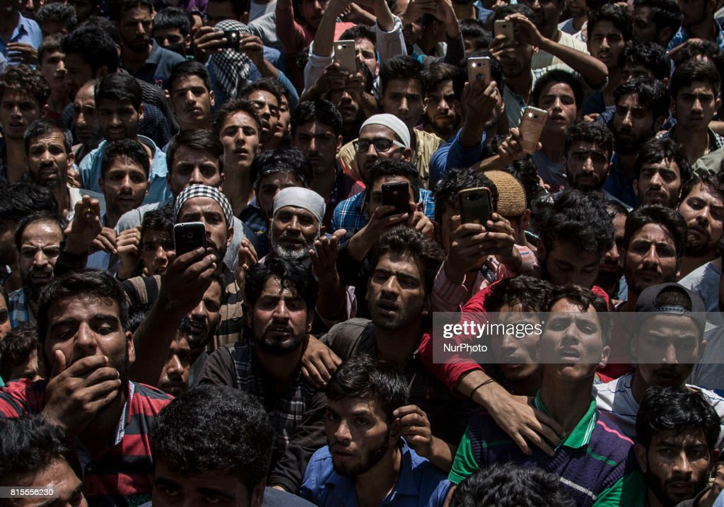 Kashmiri villagers react after looking at the body of a local rebel Parvaiz Mir during his funeral, Sunday, July 16, 2017, in Pohoo village 38 kilometers (24 miles) south of Srinagar, Indian-administered Kashmir. Mir was killed along with two other rebels including a foreign national in a gunfight at a forest area in south Kashmirs Pulwama district on Saturday, police said.