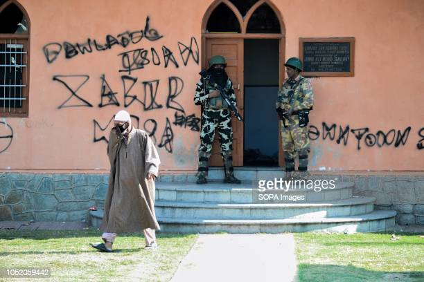 Kashmiri voter walks out of a voting booth at a polling station during the third phase of local elections in Srinagar Indian administered Kashmir The...