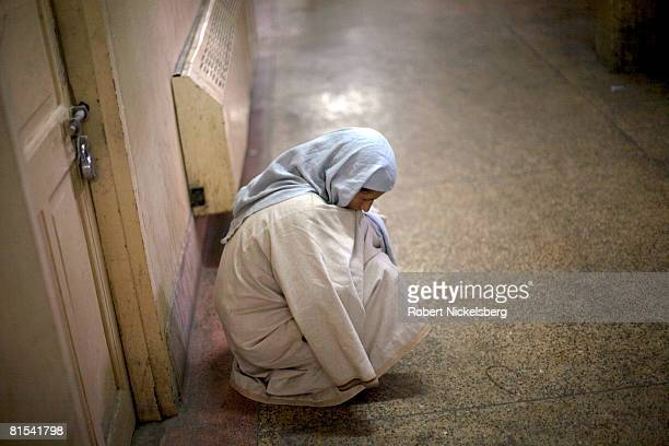 Kashmiri widow Farida Sunderwani 34 years whose husband was killed in a militantIndian Army crossfire in 1992 rests in the hallway after being...