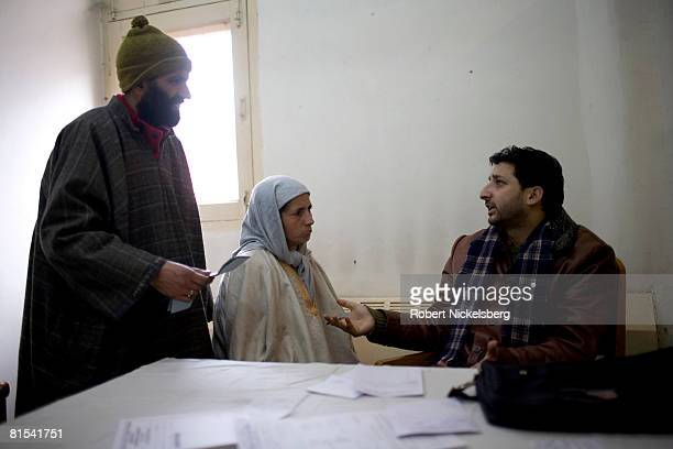 Kashmiri widow, Farida Sunderwani, center, 34 years, whose husband was killed in a militant-Indian Army crossfire in 1992, is treated by psychiatrist...